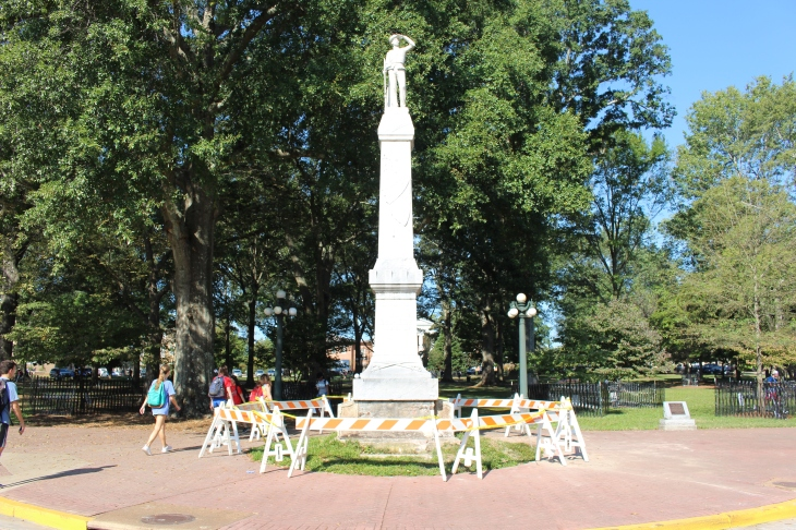 Confederate Statue surrounded by a barricade after a suspected drunk driver crashed into it.